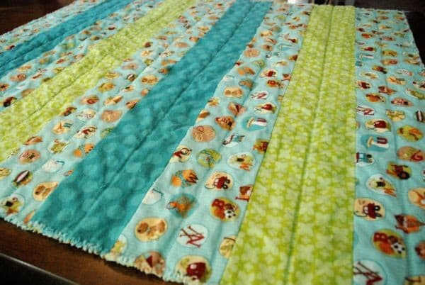 3d8db0c1c70d5 DIY 3 Hour Flannel Strip Baby Quilt