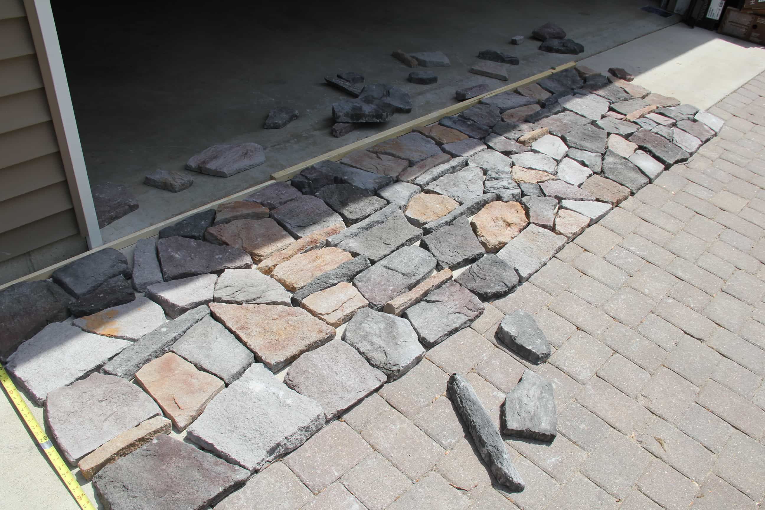 How to lay out stone before adding to home exterior
