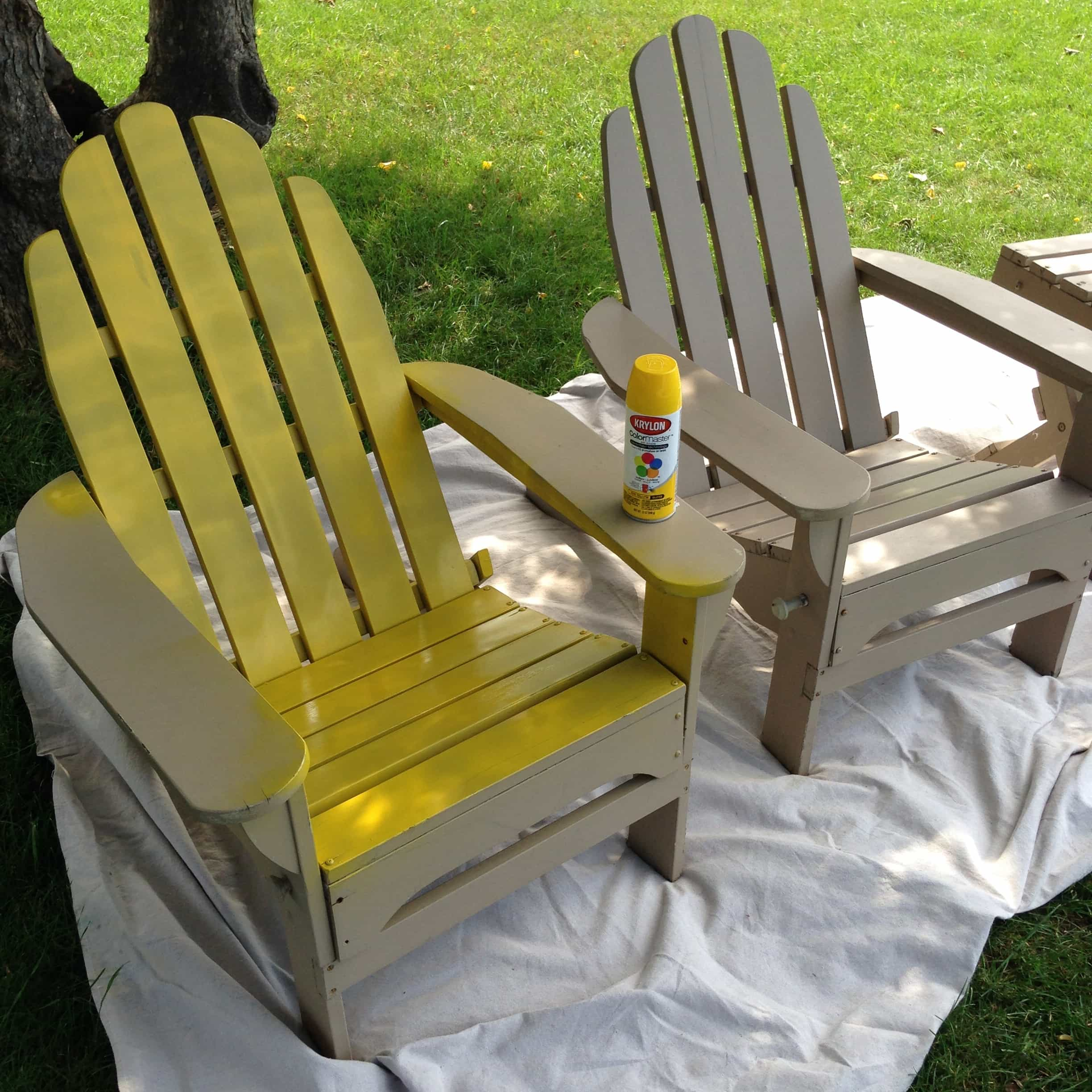 a pop of red painted adirondack chairs