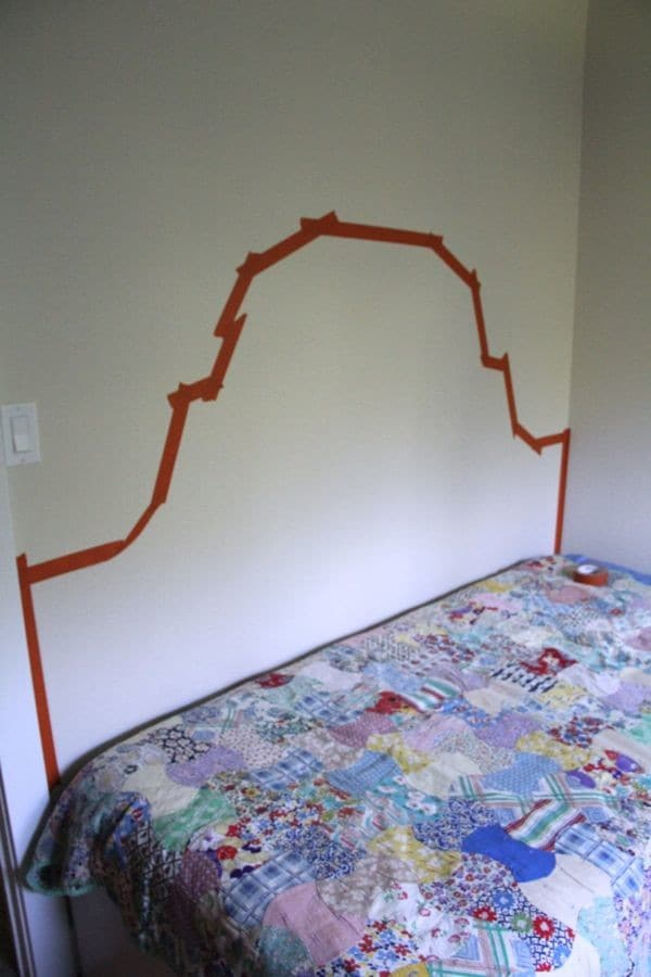 Paint a headboard on the wall