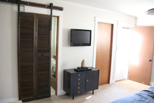Modern DIY Barn Door Hardware in Master Bedroom