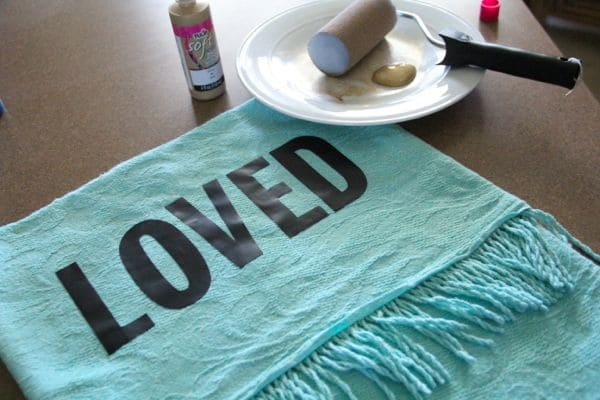 Word Stenciled onto Pillow Cover