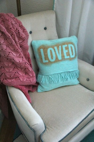 Pillow made with vintage fabric and modern stencil