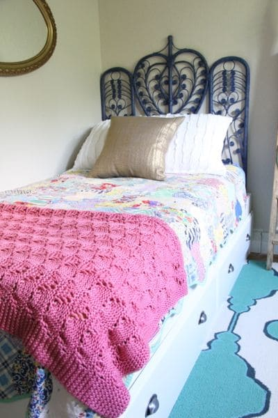 Girls Bed with Blue Wicker Headboard