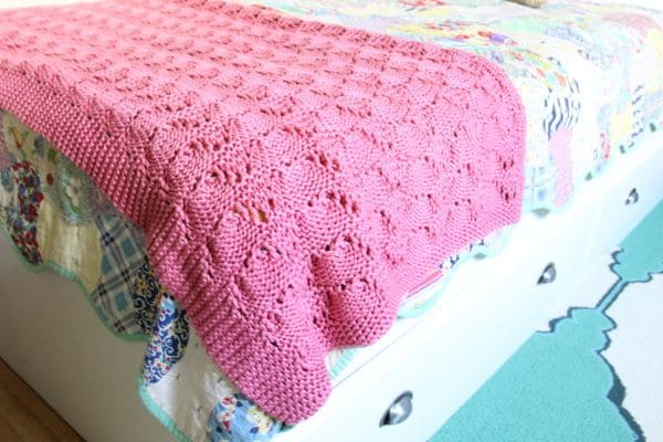 Vintage Crocheted Pink Blanket on Modern Bed
