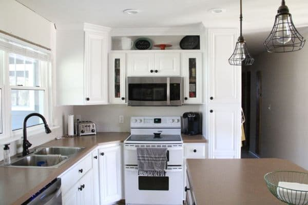 spray painting kitchen cabinets white how to spray paint cabinets like the pros bright green door 26532