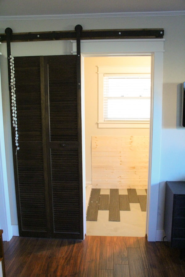 Barn door to master bathroom
