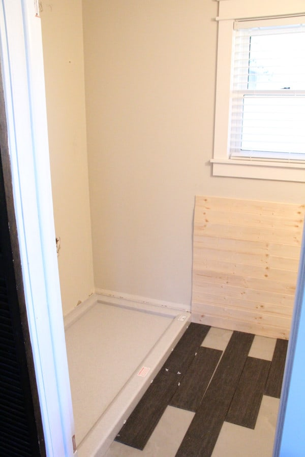 Bathroom with planked walls and planked tile floor