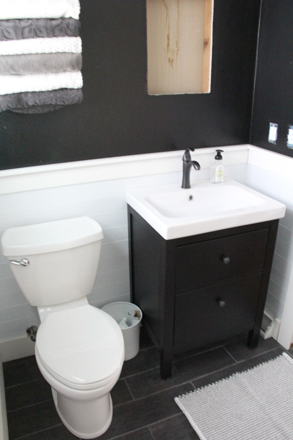 Bathroom With Planking And Black Walls