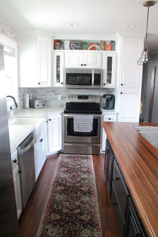 Wood Counters, White Cabinets, Tile Backsplash