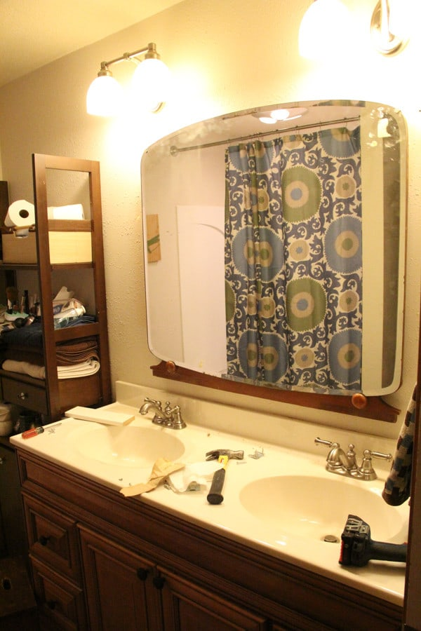 Use antique vanity mirror in a bathroom