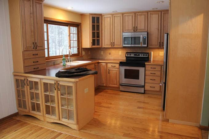 Kitchen with Unpainted Cabinets