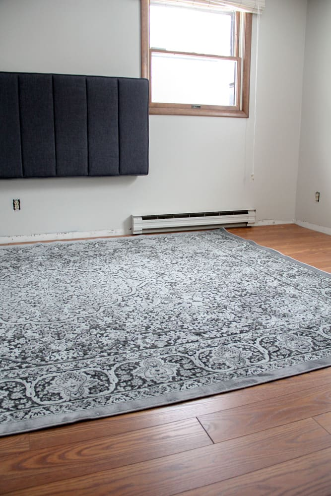 Black patterned rug on laminate Floors