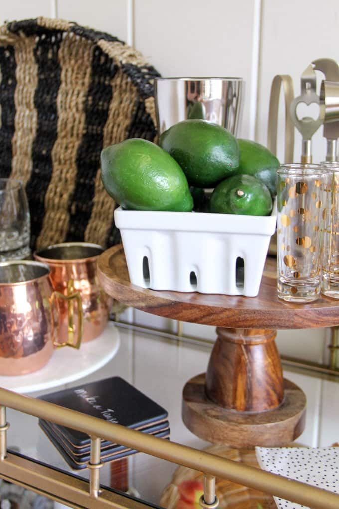 Limes staged on bar cart