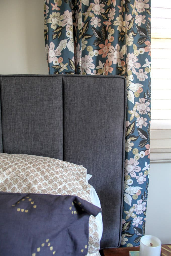 hanging curtains behind a headboard