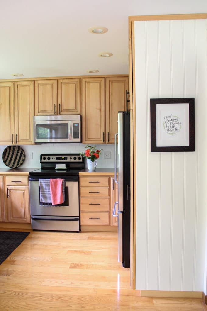 White Pantry Side Panel on Wood Cabinets