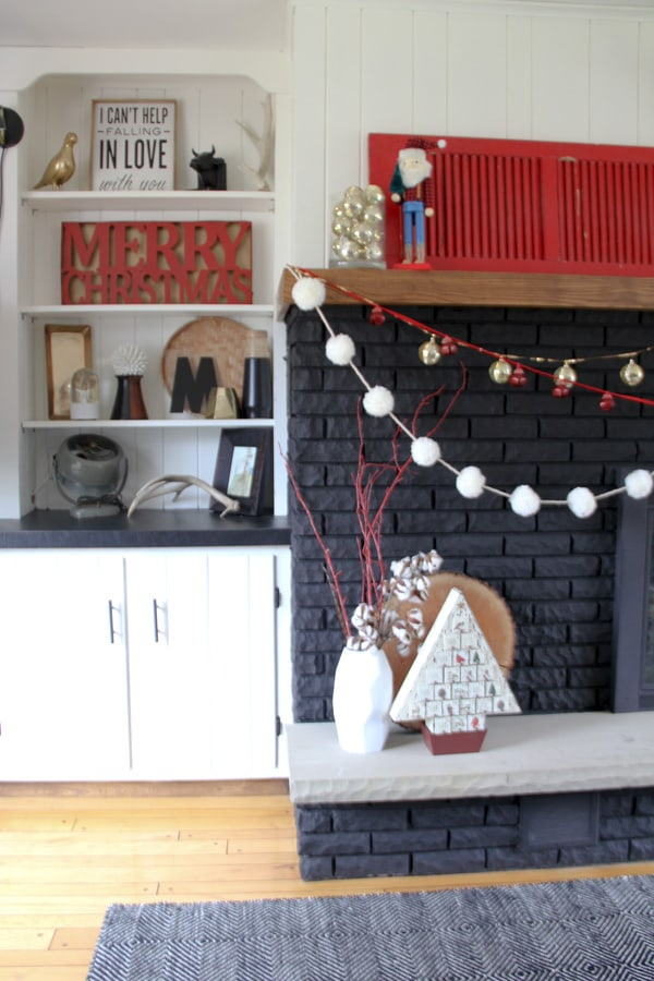 Black Fireplace Decorated for Christmas