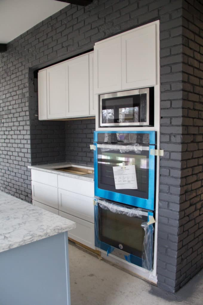 Oven and Cabinets Built into Brick Wall