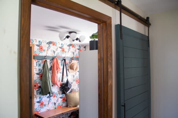 Mudroom with Barn Door and Floral Wallpaper