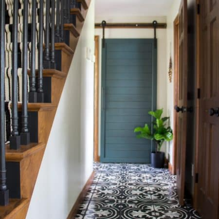 Painted Cement Tile Floors with Green Barn Door