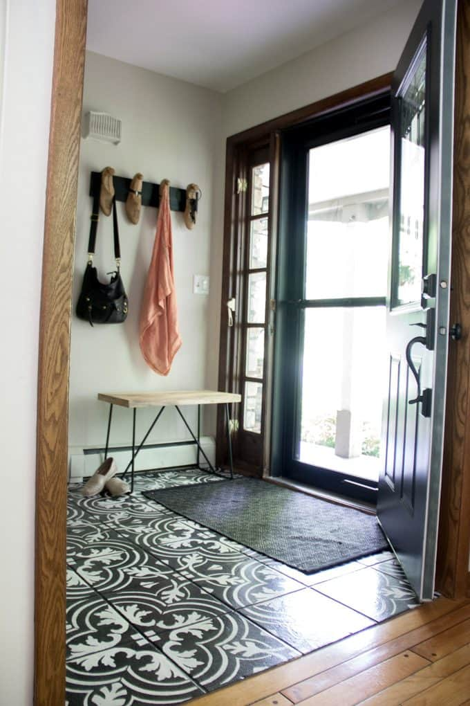 Entry with Cement Tile and Storm Door
