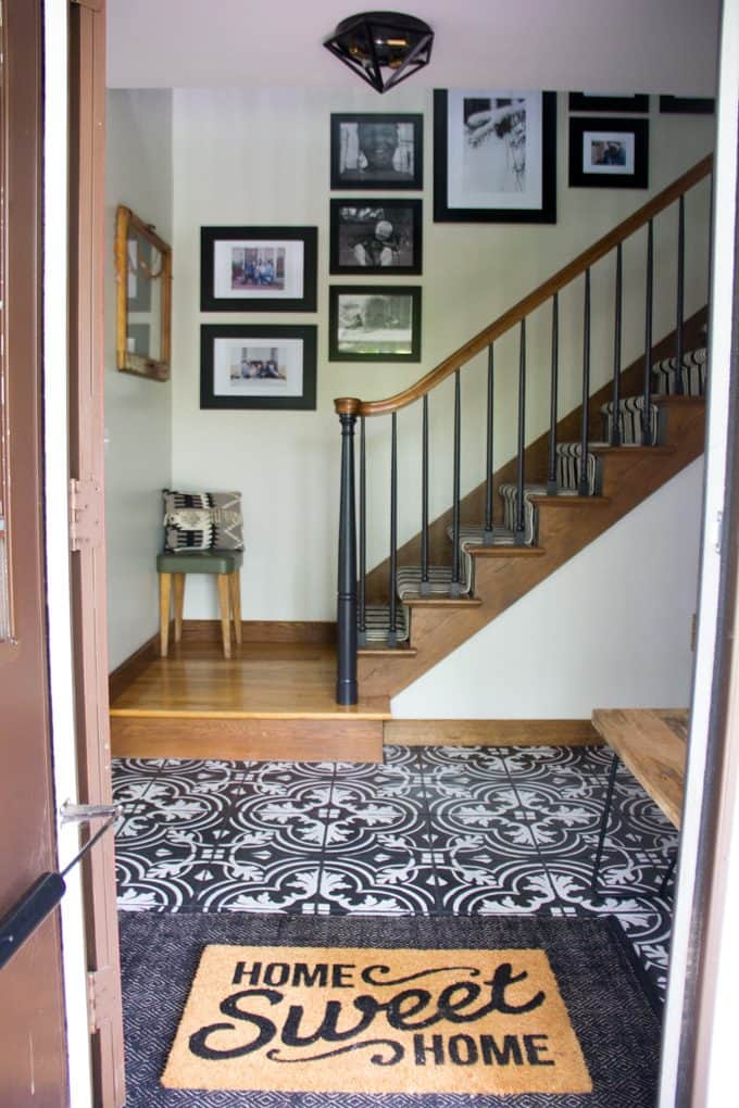 Front Entry with Cement Tile and Stairwell