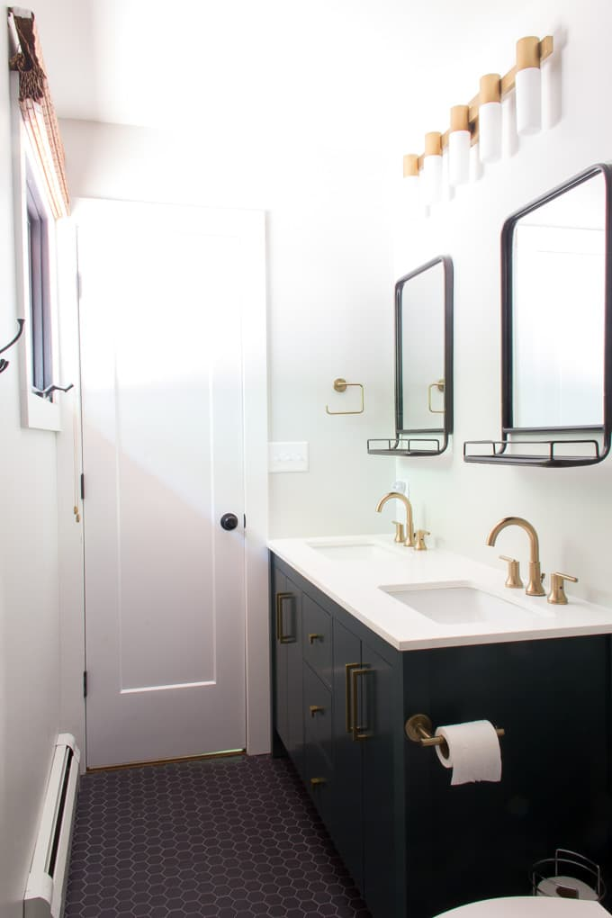 Modern Bathroom with Green Vanity and Brass Fixtures