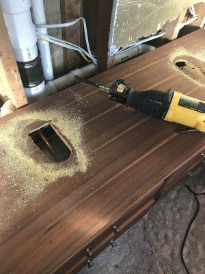 Cut hole in dresser