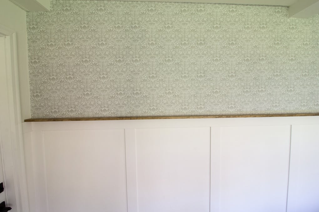 Wallpaper above faux wainscoting