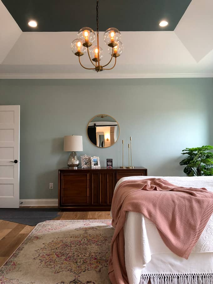 Mid Century Bedroom with Brass Chandelier