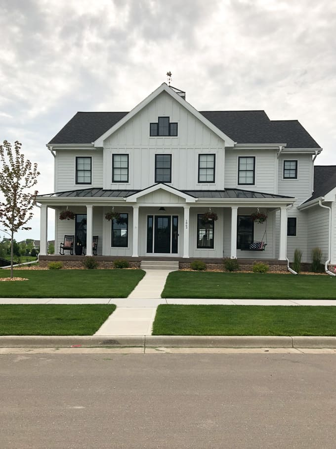 Farmhouse with Modern White Exterior Two Story House with Black Windows, Black Roof, and Black Front Door