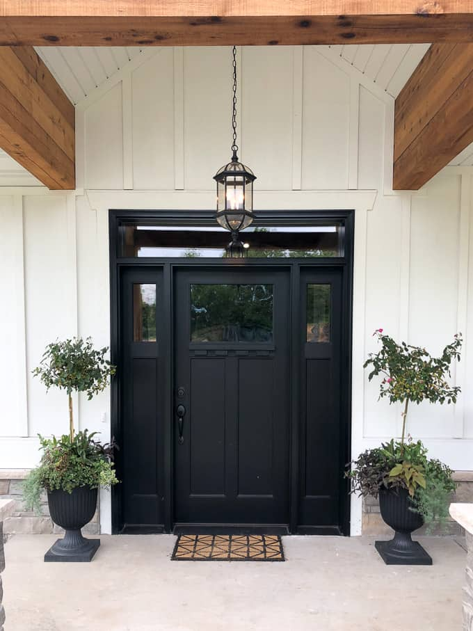 Black Front Door With White House Exterior