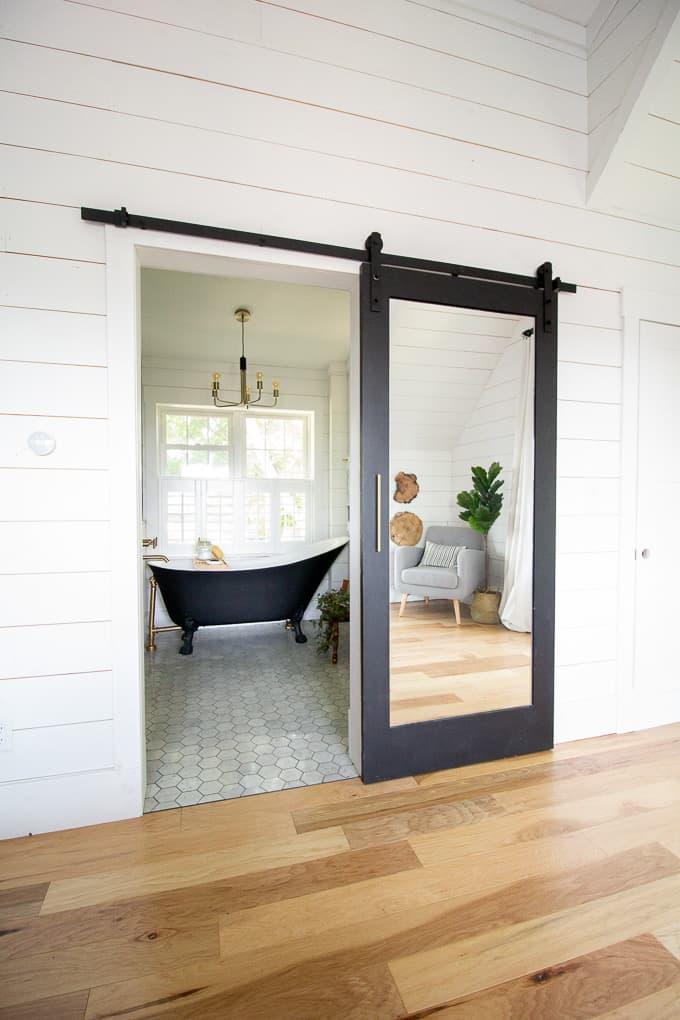 Black Mirrored Barn Door on Bathroom