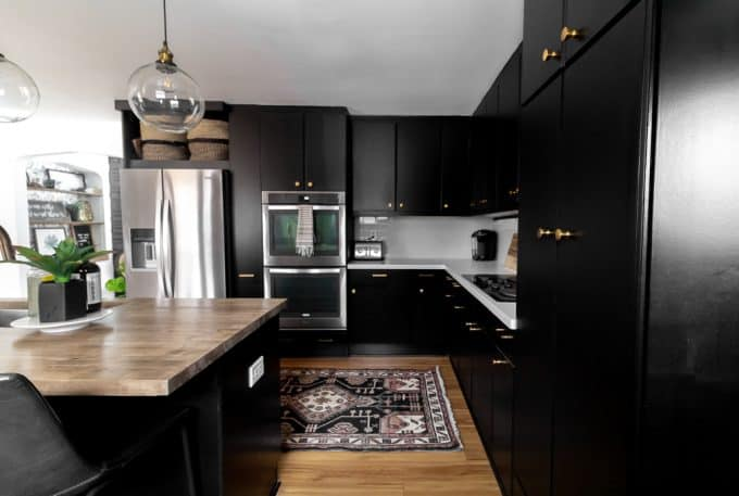 Black Kitchen with Brass Cabinets