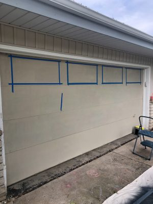 Taped off Garage Windows