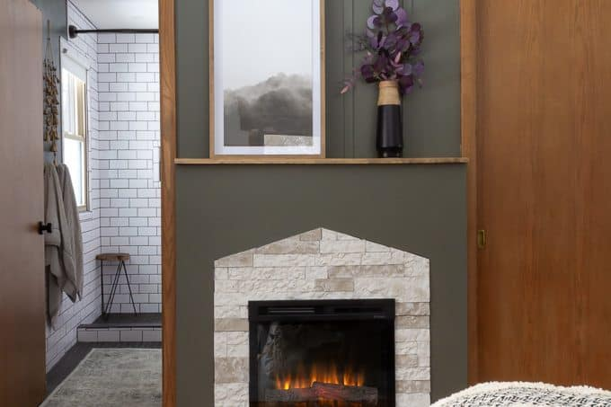 Master Bedroom Fireplace with Stone and Green